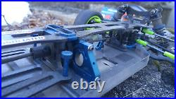 Team Associated RC10 B44 with upgrades, spare parts, box, and extra wheels/tires